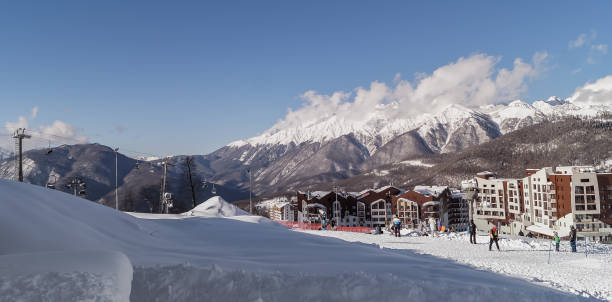 Views of the Olympic village Rosa Khutor - Olympic Winter games 2014. February  02, 2016, Rosa Khutor, Sochi, Russia -  Landscape with the Olympic village Rosa Khutor, the place of  the Olympic Winter games 2014, Krasnaya Polyana, Sochi, Russia. 2014 stock pictures, royalty-free photos & images