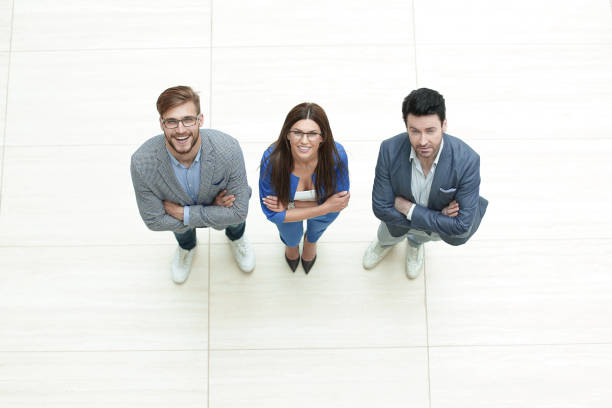 view.three business colleagues standing together stock photo