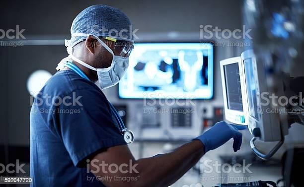 Vigilantly Monitoring His Patients Vitals Stock Photo - Download Image Now