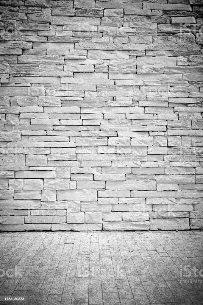 Vignet lichte Loft muur van stenen blokken met vloer foto