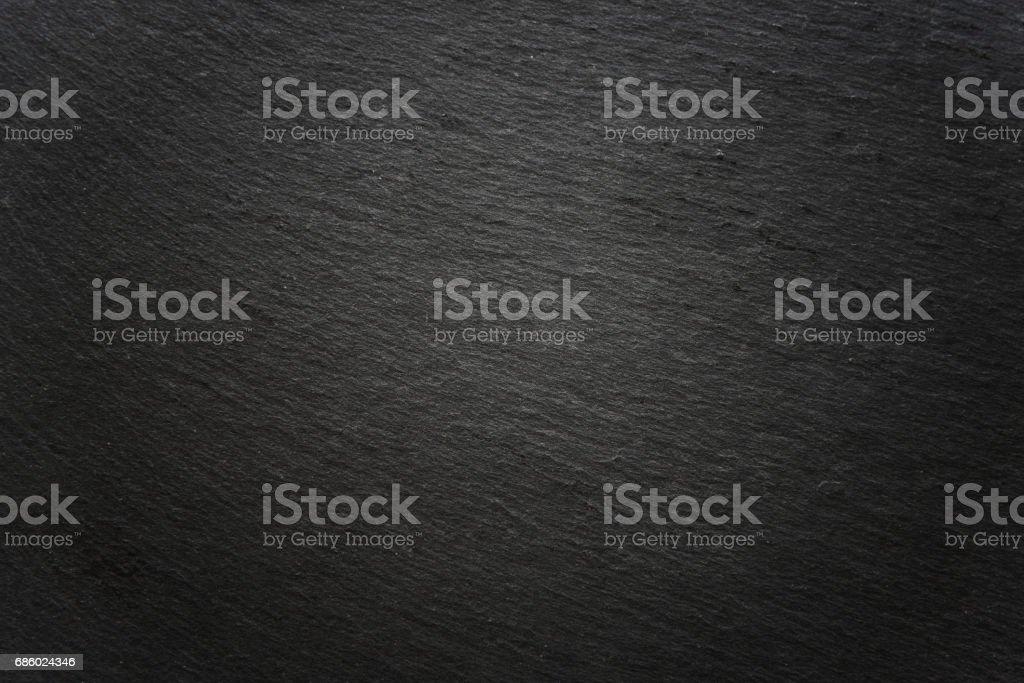 vignetted dark gray slate surface background – Foto