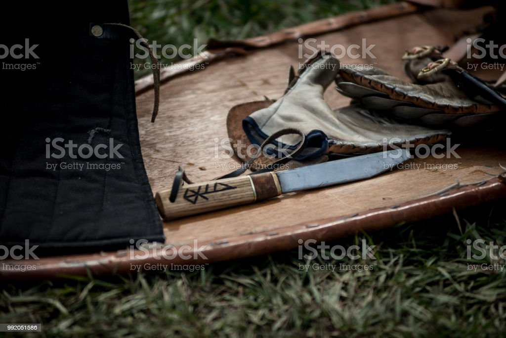 Viking Age Knife Lying On The Back Of A Wooden Kite Shield Stock