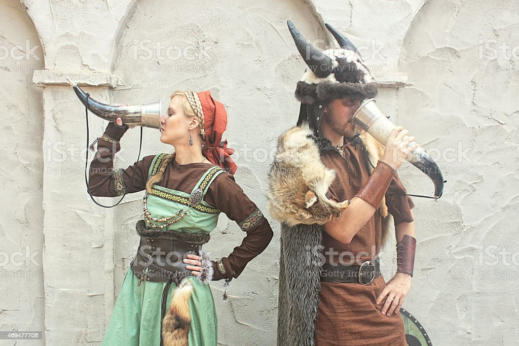 Viking Barbarians Drinking From Decorated Horns stock photo