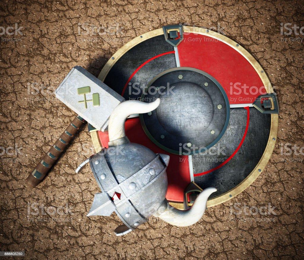 Viking helmet, round shield and hammer on cracked soil stock photo