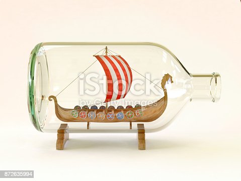 istock Viking ship in glass bottle on a white background 3d rendering 872635994