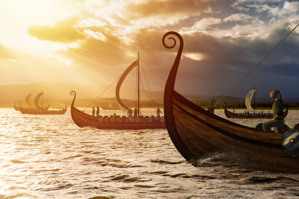 Viking ships on the water under the sunlight and dark storm stock photo