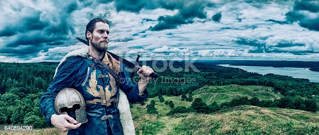 istock Viking warrior stands on hill overlooking the landscape 640894290