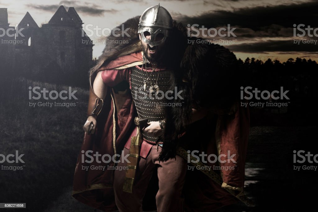 Viking warrior with sword over black background stock photo