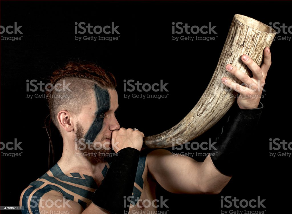 Viking with horn stock photo