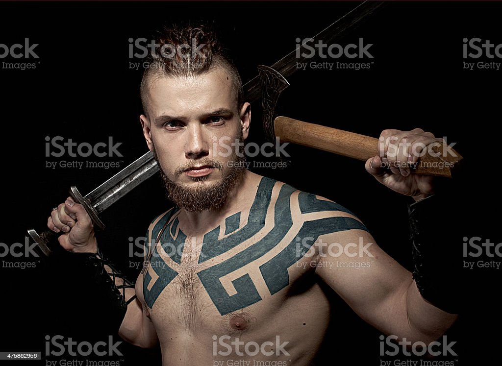 Viking with sword and axe stock photo