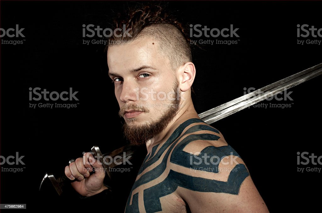Viking with sword on black background stock photo