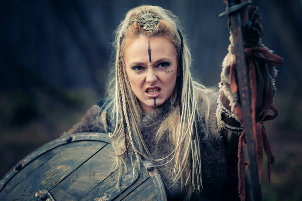 Viking woman warrior in the attack. Sward and shield. Close-up portrait. Book Cover stock photo