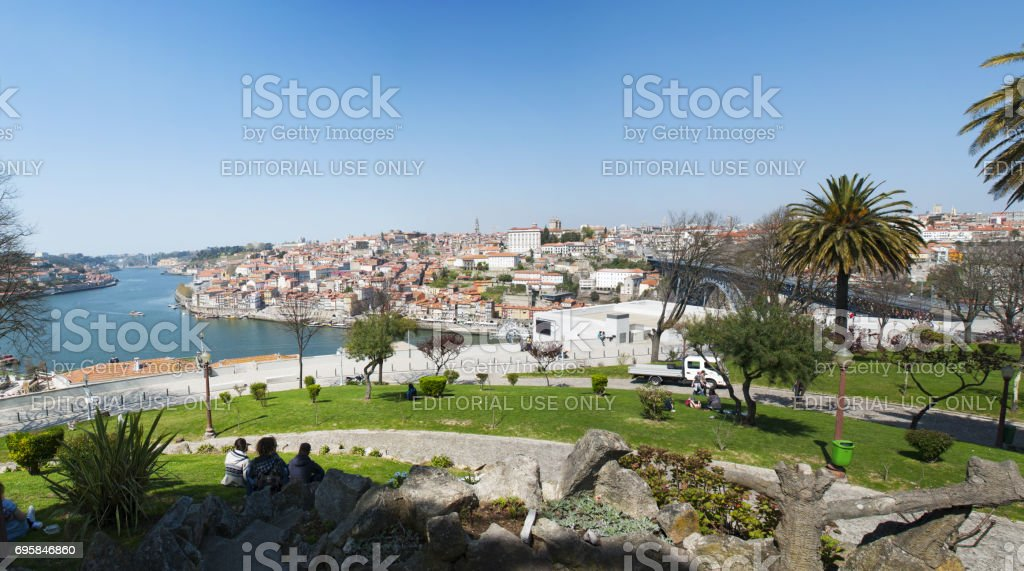 Vila Nova de Gaia: people chilling out on the grass at the Jardim do Morro, a little public park on the hill of the city of Vila Nova de Gaia, in front the Old City of Porto stock photo