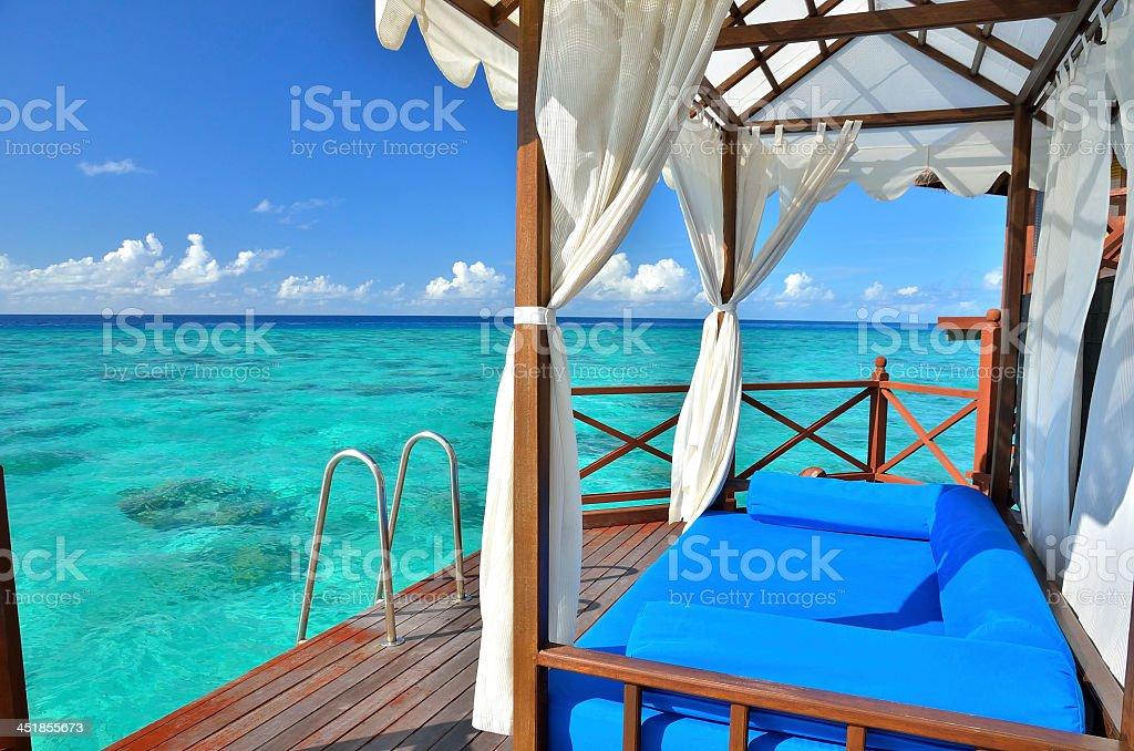 Villa balcony overlooking the tropical sea stock photo