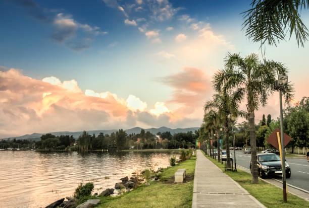 Villa Carlos Paz, footpath on the shores of San Roque lake, Córdoba, Argentina. stock photo