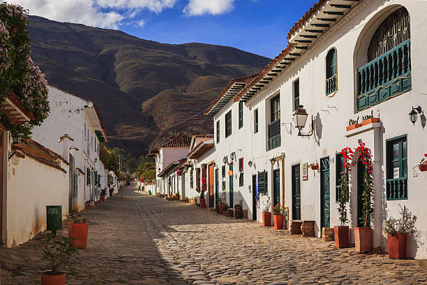 Villa de Leyva, Colombia: Looking Up Calle 14 In The Early Morning Sunlight Towards The Mountains In The Historic 16th Century Andean Town stock photo
