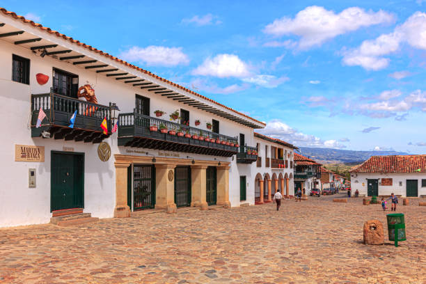 Villa de Leyva, Colombia - The South Western Side and Western Corner Of The Cobblestoned Plaza Mayor In The Historic 16th Century Colonial Town of Villa de Leyva, in The Boyacá Department, In The Morning Sunlight stock photo
