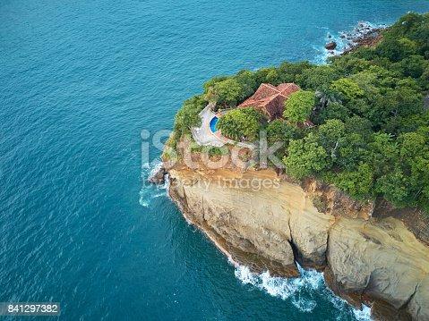 istock Villa in ocean big rock 841297382