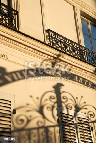 "The facade of an old building in Paris where famous painters like Cezanne or Toulouse-Lautrec used to live and work. We can see the shadow of the entrance gate saying ""Villa des arts""."