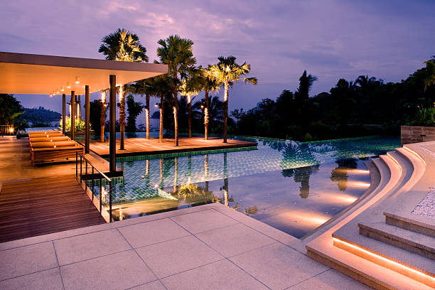 villa swimming pool sunset - hawaii home stock photos and pictures