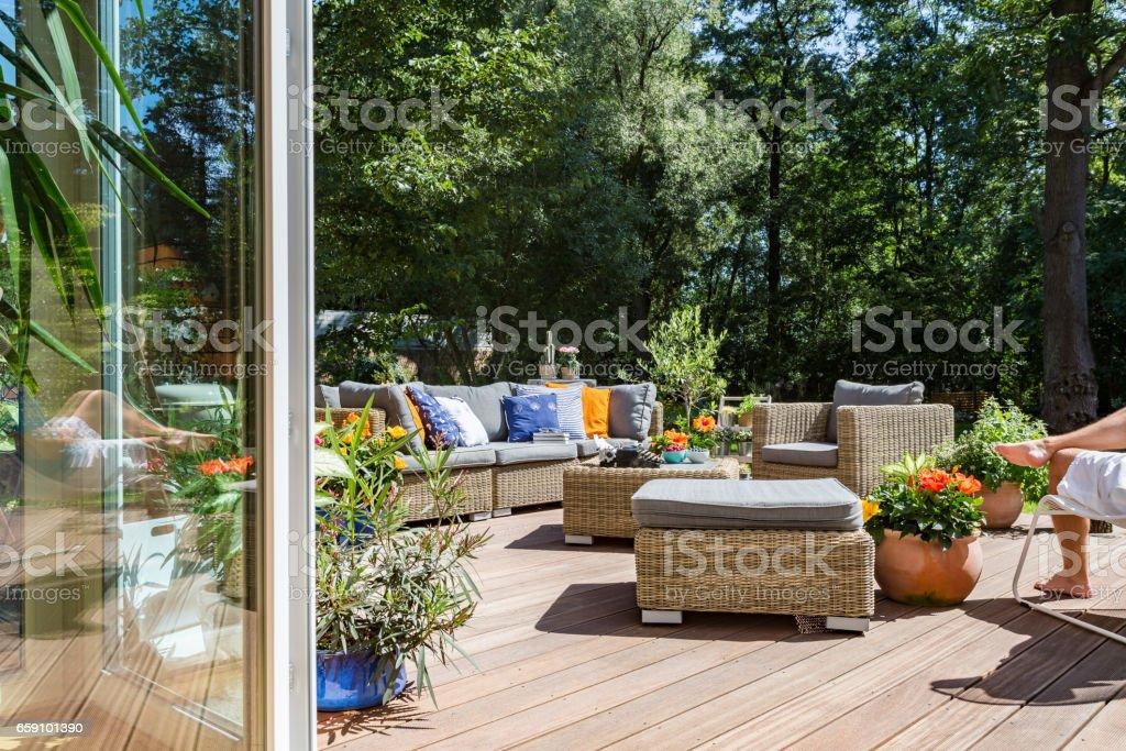 Villa terrace with rattan furniture stock photo