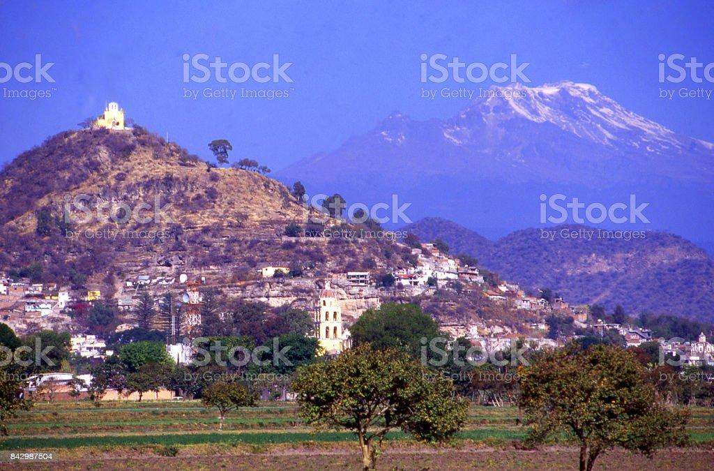 Village and mountain-top church with volcano of Popocatépetl near Puebla Mexico stock photo
