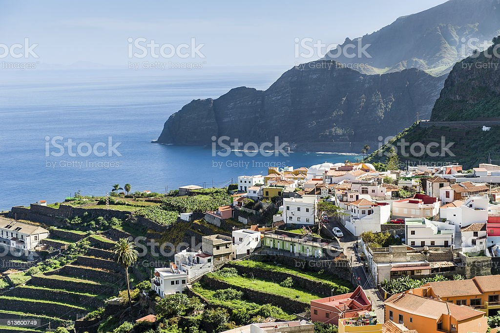 Village at Atlantic ocean shore and high rocks. stock photo
