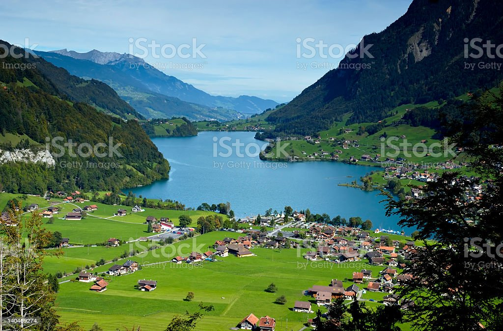 A village at the base of mountains near a lake royalty-free stock photo