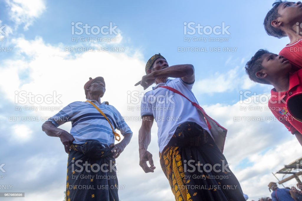 Village Elders Searching for Boxing Participants stock photo