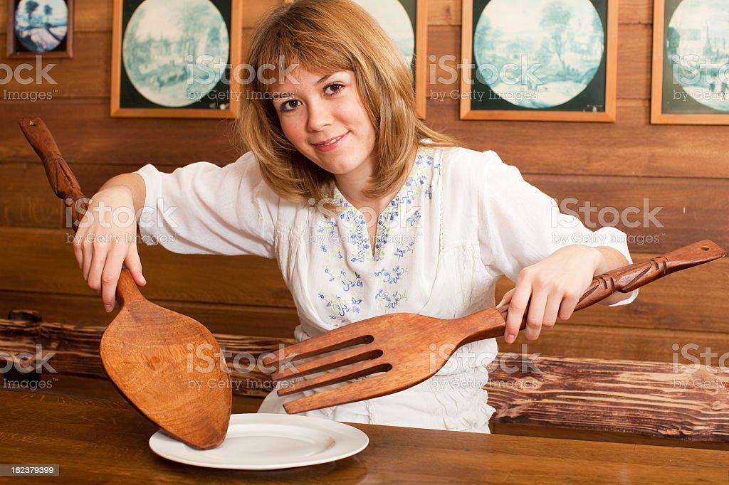 Village Girl at restaurant: eating stock photo
