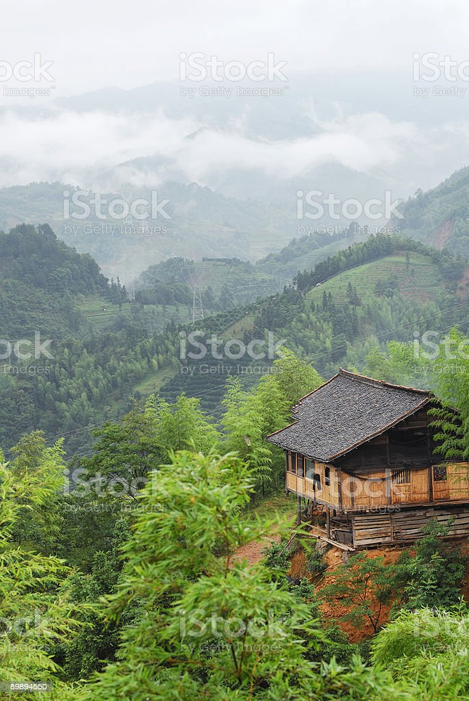 Village house in foggy mountains royalty-free stock photo