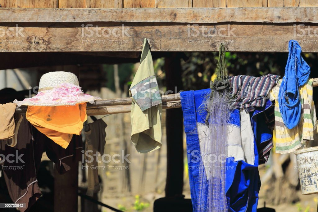 Village house-clothes hanging-Akha hill tribe. Nam Ha-Luang Namtha province-Laos. 3390 stock photo