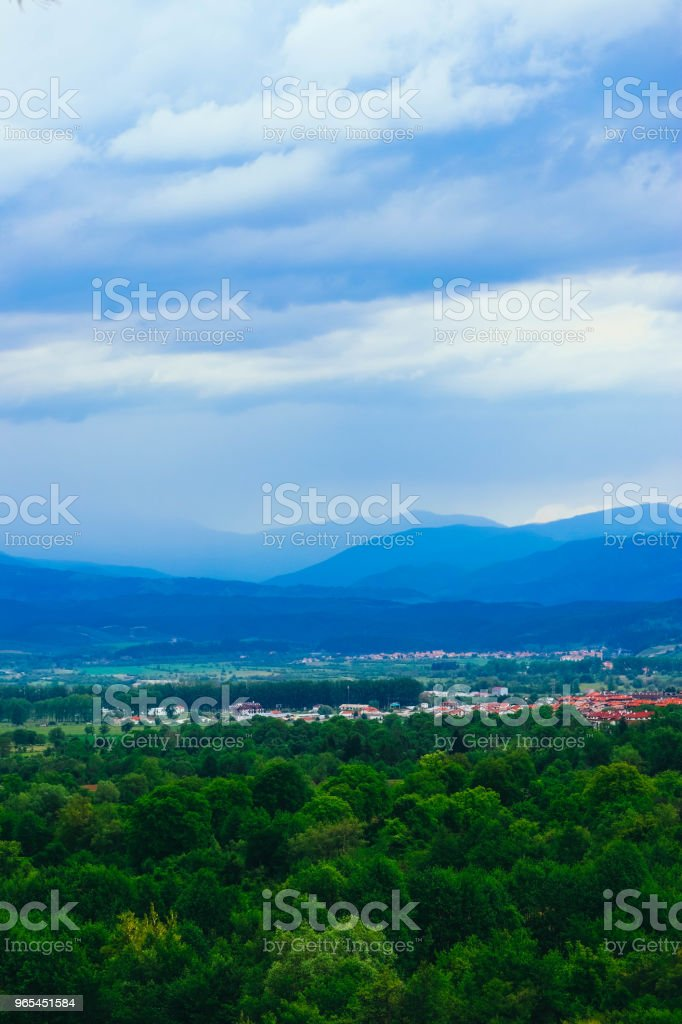 Village in a mountain landscape. Europe, Bulgaria, old town panoramic view, red roofs houses. zbiór zdjęć royalty-free