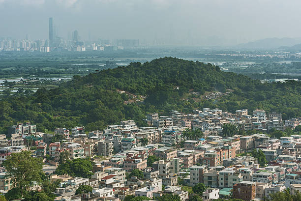 Village in Hong Kong Village in Yuen Long district in Hong Kong and Skyline of Shenzhen city of China new territories stock pictures, royalty-free photos & images