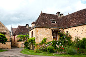 Village in Lot, in Perigord, in the South West of France. The village (Payrignac ?) is typical with yellow stone house. Périgord in France. June 13th, 2016