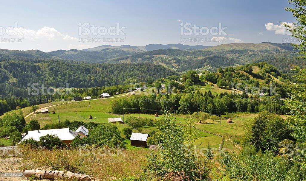 village in mountains stock photo