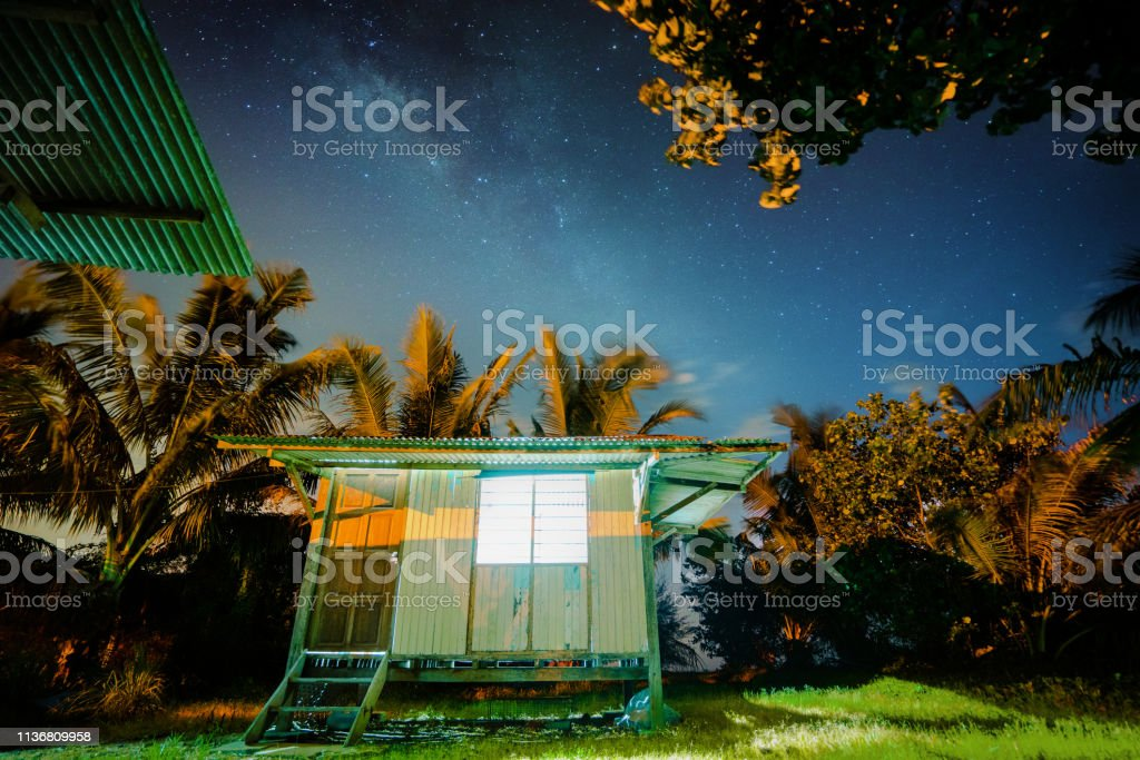 village in the forest milky way stock photo