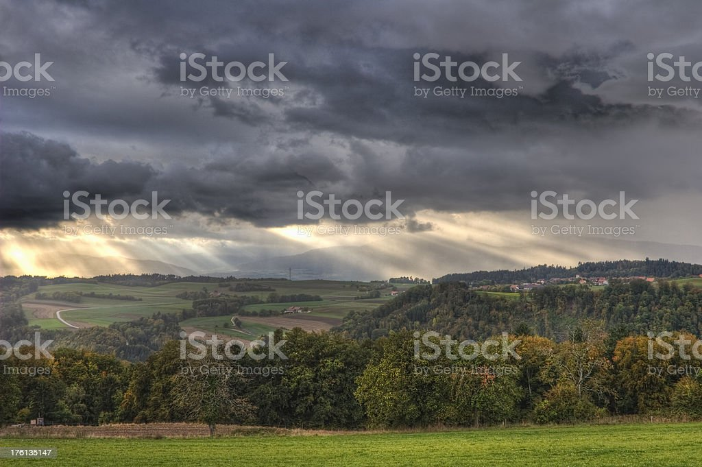 Village in Vaud under a stormy sky over the Jura stock photo