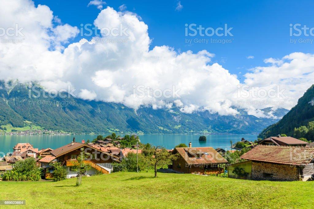 Village Iseltwald at Lake Brienz - beautiful lake in the alps at Interlaken, Switzerland stock photo