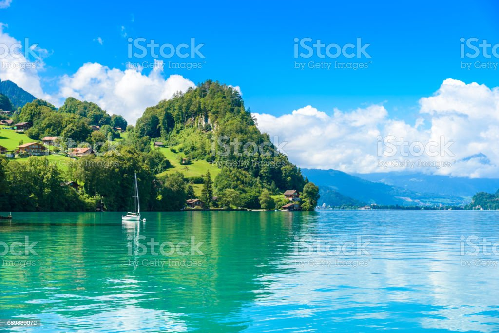 Village Iseltwald at Lake Brienz - beautiful lake in the alps at Interlaken, Switzerland stock photo