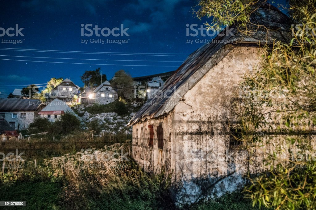 Village Lukomir at night with bright stars on the sky and moonlight stock photo