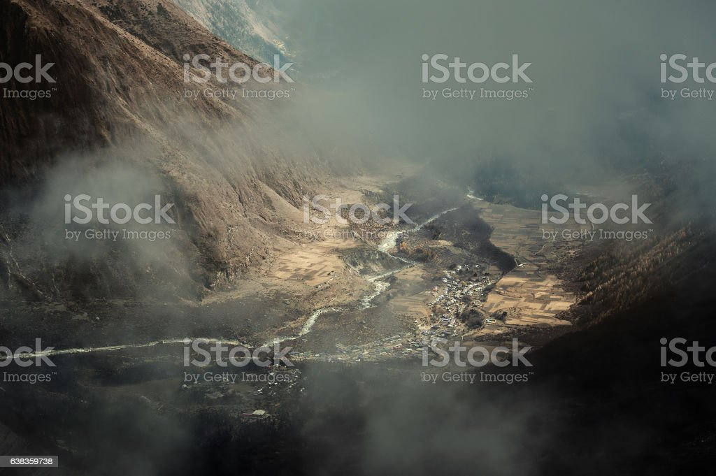 Village near the river in Nepal mountains stock photo