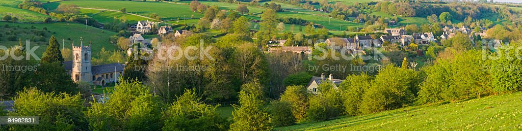 Village nestled in green valley royalty-free stock photo