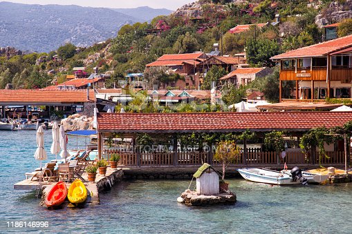 Kalekoy, Turkey - September 21, 2019: Ancient village of Simena-Kaleköy on the shores of the Mediterranean Sea in the Kekova area of the Antalya province. Antalya's Demre district located in the small town of Simena at the Lycian Union, which is the ancient city of Kaleköy, land of rare beauty is non-road transport in Turkey.