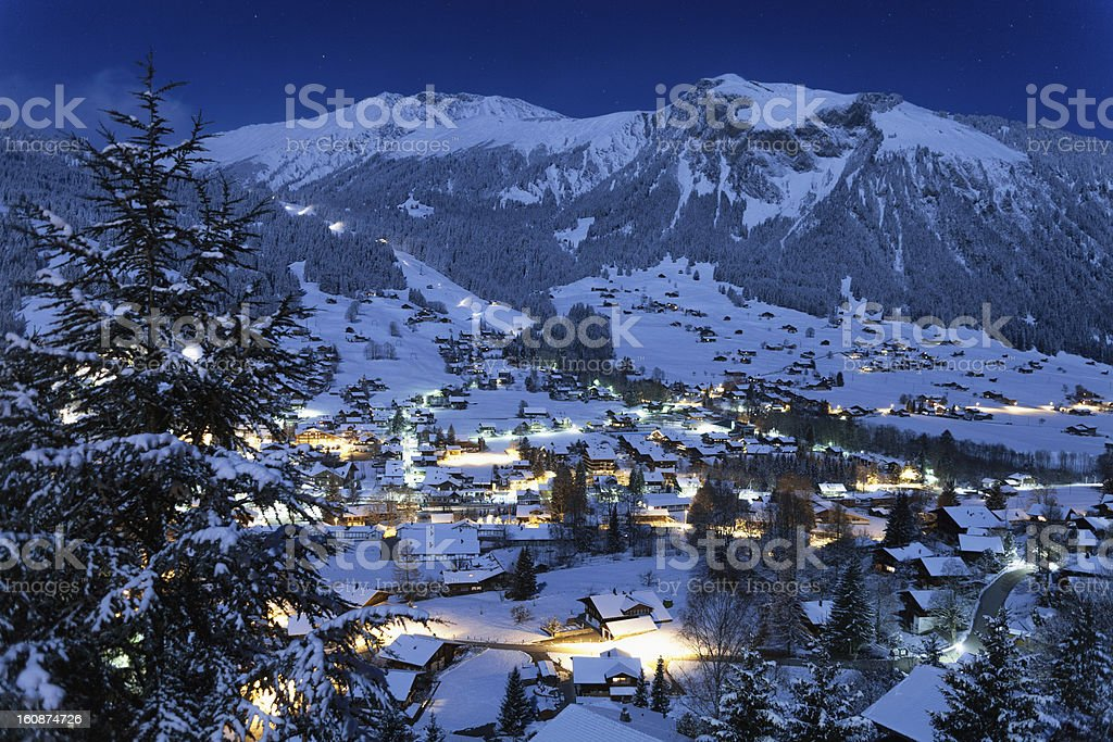 Village of Lenk, Moonlight, Fresh Snow, Time Exposure stock photo