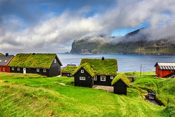 village of mikladalur, faroe islands, denmark - denmark stock photos and pictures