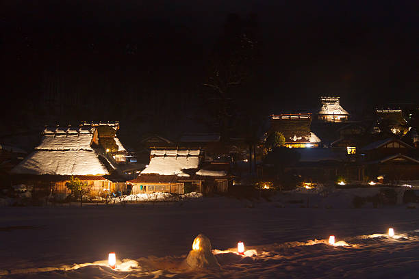 village of thatched winter light-up - satoyama scenery stock photos and pictures