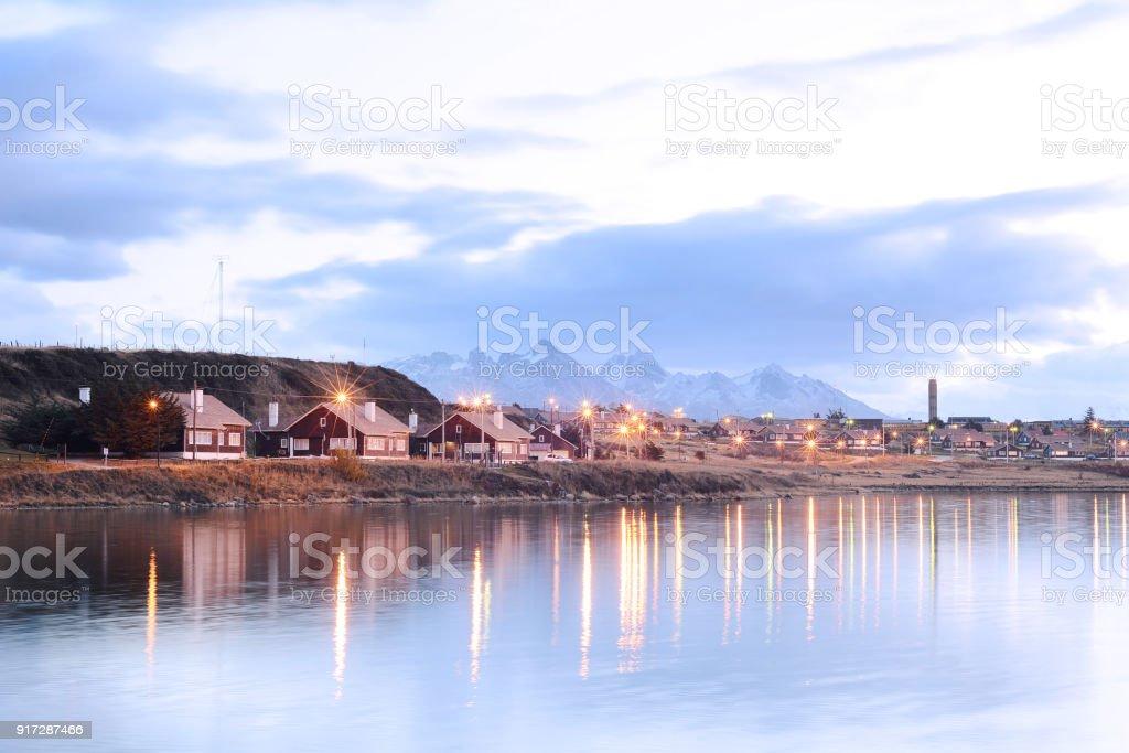 Village on river at sunset. stock photo