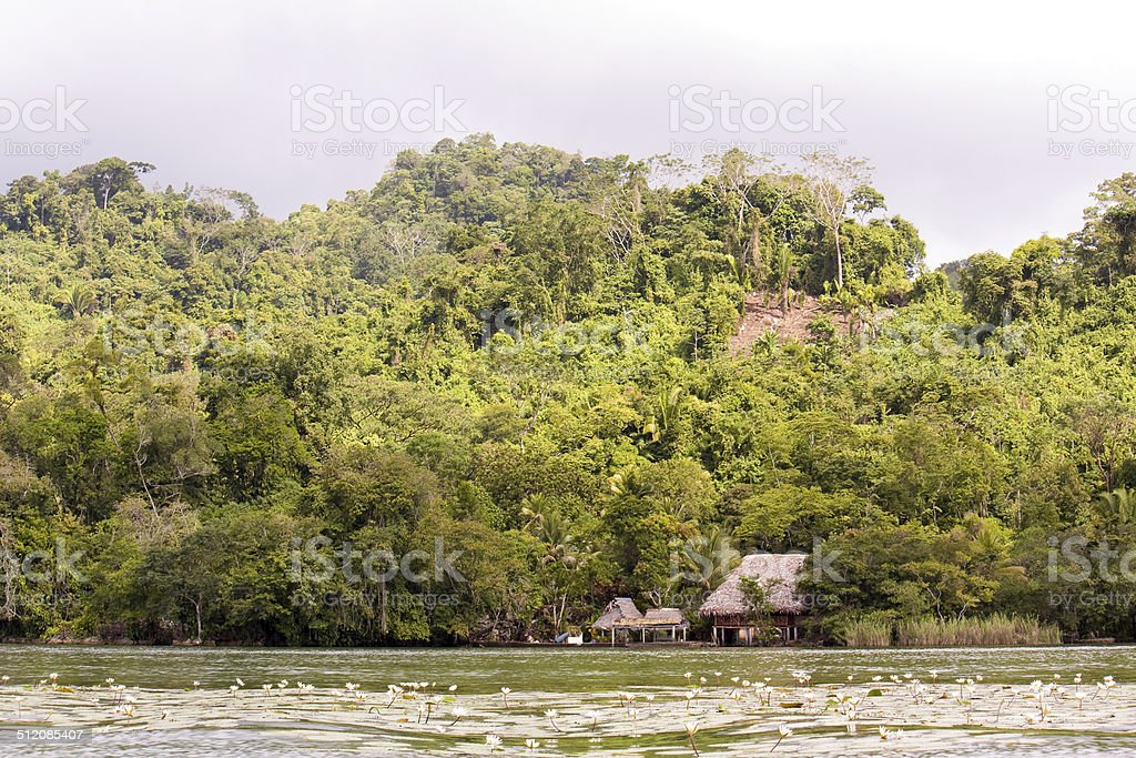 Village on the river before rain storm in Guatemala stock photo