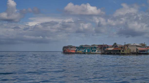 Village on the water on Guanaja island stock photo